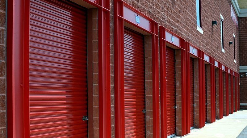 A row of red storage facilities, securely closed and locked