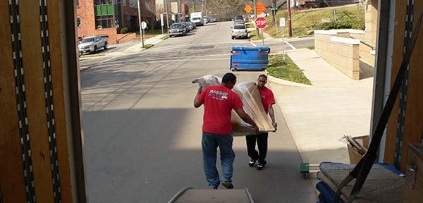Two Marrin's Moving employees loading a moving truck in North Carolina